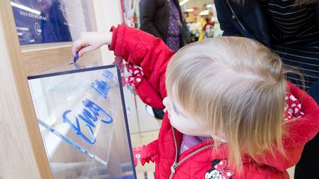 A child choosing a charity as part of Tesco's Bags of Help scheme. Picture: Kevin Lines