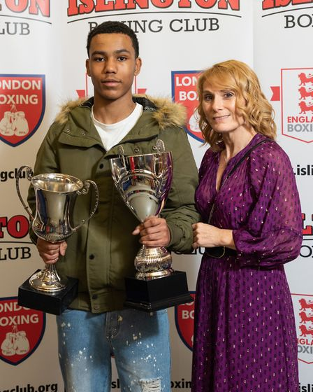 Caiden Hughes receives the Dony Spiro Trophy as most improved junior from Carrie Morrow (pic Emma Ta