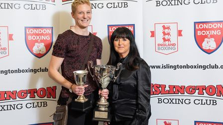 Jem Campbell receives the best female boxer award from Jackie Hagland (pic Emma Tarrant/etfightograp