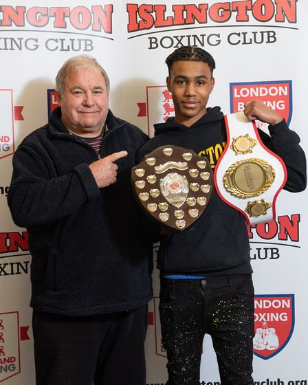 Kyron Hughes receives the Colin Webster Shield as best junior boxer from Colin Webster (pic Emma Tar