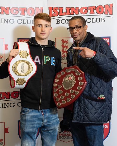 Ewan Jenkins receives the Jerry Mitchell Shield as best senior boxer from Jerry Mitchell (pic Emma T