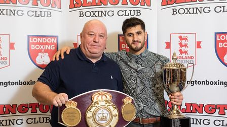 Masood Abdullah receives the Ron Hagland Memorial Trophy as best overall club boxer from Lenny Hagla