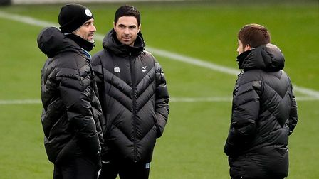 Manchester City manager Pep Guardiola (left) with assistant Mikel Arteta (centre) during the trainin