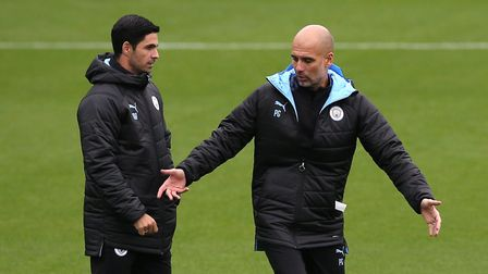 Manchester City managers Mikel Arteta (left) and Pep Guardiola during the training session at the Ci