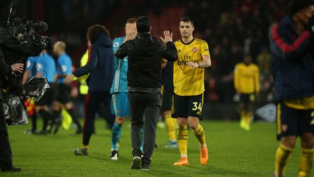 Arsenal's Granit Xhaka (right) with manager Mikel Arteta (left) after the final whistle at Bournemou