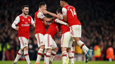 Arsenal's Sokratis Papastathopoulos celebrates scoring his side's second goal of the game during the