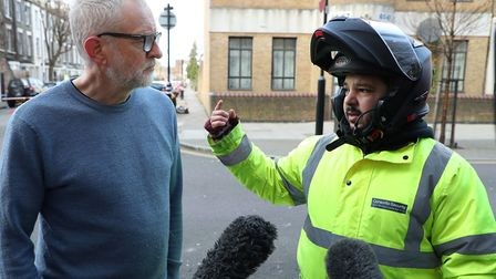 Jeremy Corbyn speaking with Deliveroo rider Zakaria Gherabi, who knew the victim of the fatal stabbi