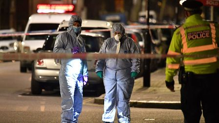 Forensic officers at the crime scene In Finsbury Park. Picture: Dominic Lipinski/PA Wire