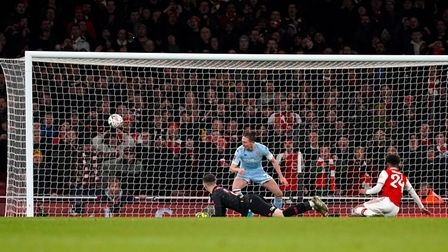 Arsenal's Reiss Nelson scores his side's first goal of the game during the FA Cup third round match