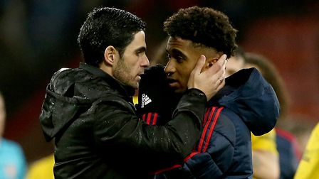Arsenal's manager Mikel Arteta (left) with Reiss Nelson (right) after the final whistle during the P