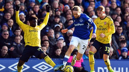 Everton's Tom Davies (centre) gets away from Arsenal's Bukayo Saka (left) and Emile Smith Rowe