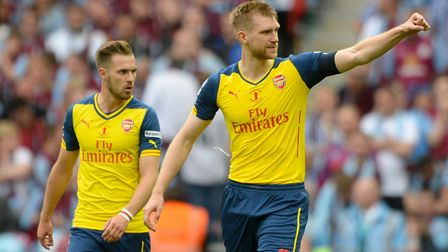 Arsenal's Per Mertesacker (right) celebrates scoring his side's third goal during the FA Cup Final a