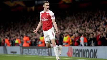 Arsenal's Aaron Ramsey celebrates scoring his side's first goal of the game. Picture: Adam Davy/PA