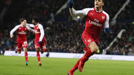 Arsenal's Alexis Sanchez celebrates after his side's first goal of the game during the Premier Leagu
