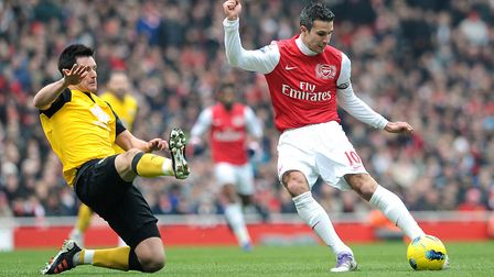 Arsenal's Robin van Persie (right) shoots at goal. Picture: Anthony Devlin/PA