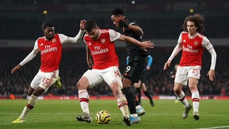 Arsenal's Ainsley Maitland-Niles, Sokratis Papastathopoulos, Manchester United's Anthony Martial and
