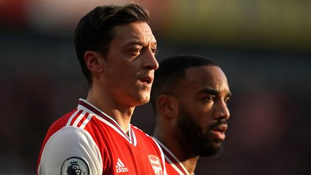 Arsenal's Mesut Ozil (left) and Alexandre Lacazette have worn the captain's armband as part of the c