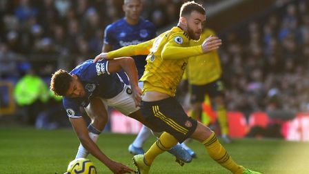 Everton's Dominic Calvert-Lewin (left) and Arsenal's Calum Chambers battle for the ball during the P