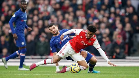 Chelsea's Mateo Kovacic (left) and Arsenal's Reiss Nelson battle for the ball during the Premier Lea