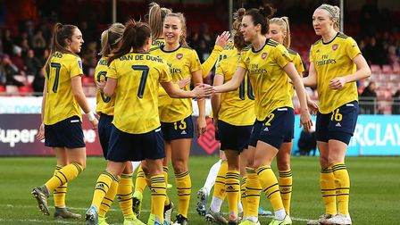 Arsenal's Danielle van de Donk celebrates with team mates after scoring her sides first goal of the