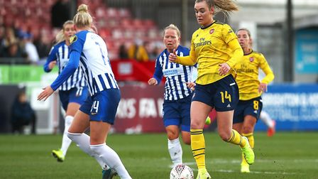 Arsenal's Jill Roord brings the ball forward during the Women's Super League match at The People's P