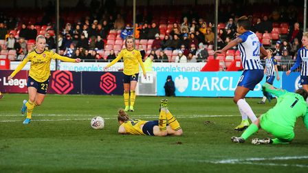Arsenal's Beth Mead (left) scores her sides fourth goal of the match during the Women's Super League