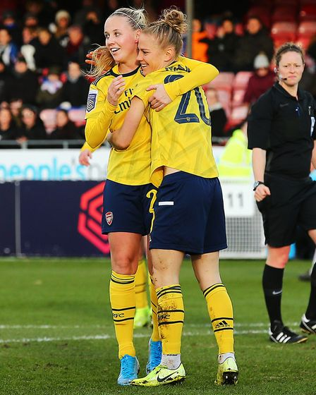 Arsenal's Beth Mead (left) celebrates scoring her sides fourth goal of the match with Victoria Willi