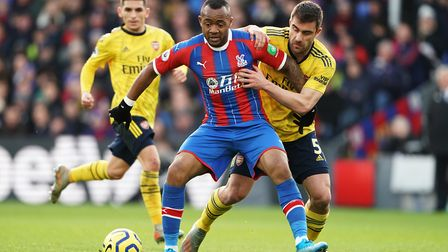 Crystal Palace's Jordan Ayew and Arsenal's Sokratis Papastathopoulos (right) battle for the ball dur