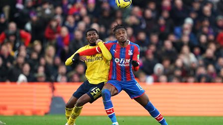 Arsenal's Ainsley Maitland-Niles (left) and Crystal Palace's Wilfried Zaha battle for the ball durin