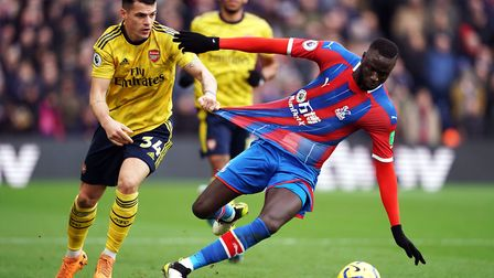 Crystal Palace's Cheikhou Kouyate (right) and Arsenal's Granit Xhaka battle for the ball during the