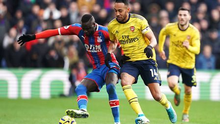 Crystal Palace's Cheikhou Kouyate (left) and Arsenal's Pierre-Emerick Aubameyang battle for the ball