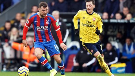 Crystal Palace's James McArthur (left) and Arsenal's Mesut Ozil battle for the ball during the Premi