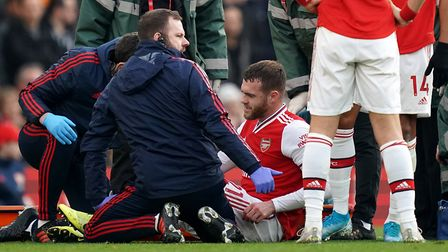 Arsenal's Calum Chambers receives treatment after picking up a knee injury. Picture: John Walton/PA
