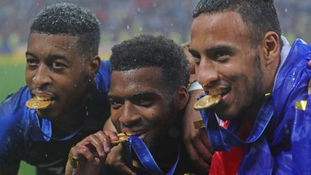 France's Presnel Kimpembe (left), Thomas Lemar andCorentin Tolisso celebrate after winning the FIFA