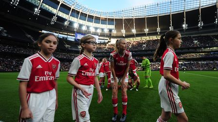 Arsenal's Leah Williamson talks to the mascots before the FA Women's Super League match at the Totte