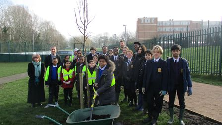 St Gregory's pupils with other community members on a tree planting day in Woodcock Park. Picture: