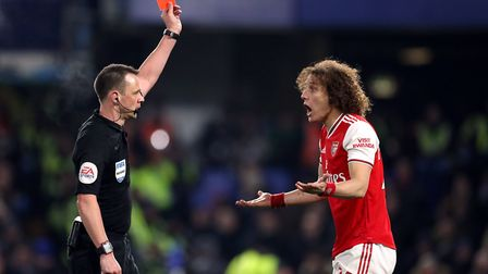 Arsenal's David Luiz is shown a red card by referee Stuart Attwell during the Premier League match a