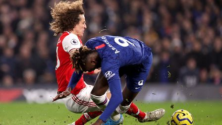 Arsenal's David Luiz fouls Chelsea's Tammy Abraham before being shown a red card during the Premier