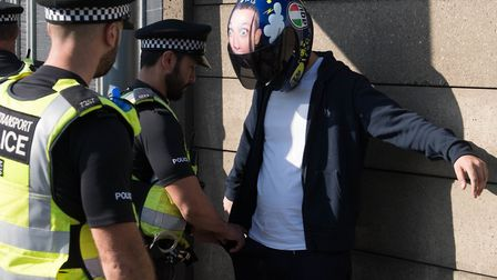 Stock image of police carrying out a stop and search. Picture: Stefan Rousseau/ PA