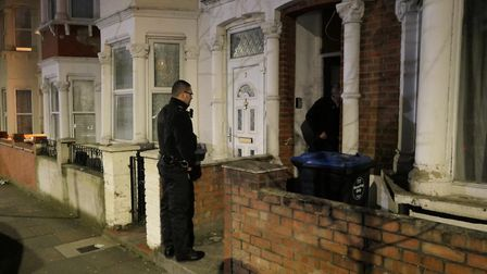 Police officers conducting a drugs raid in St Thomas Road Harlesden. Picture: David Nathan