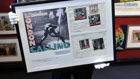"""The original album cover artwork for by Ray Lowry for """"London Calling"""" by the Clash is seen during a"""