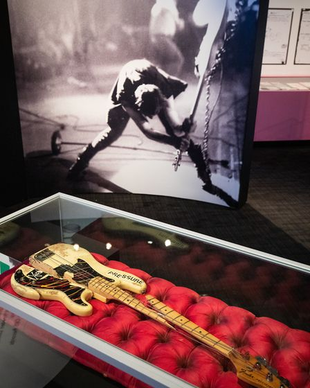 Paul Simonon's Fender Precision Bass Guitar damaged on stage at the Palladium 1979 on display during