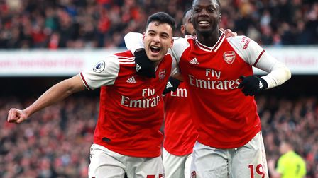 Arsenal's Gabriel Martinelli (left) celebrates scoring his sides first goal of the game with Nicolas