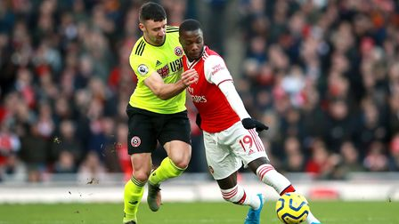 Sheffield United's Enda Stevens (left) and Arsenal's Nicolas Pepe battle for the ball during the Pre