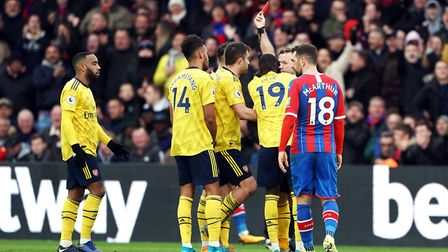 Referee Paul Tierney shows Pierre-Emerick Aubameyang (second left) a red card following a VAR review