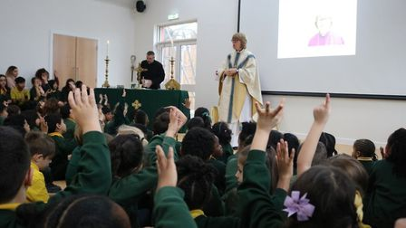 Bishop of London Sarah Mullally holds a special service in John Keble primary's new hall. Picture: D