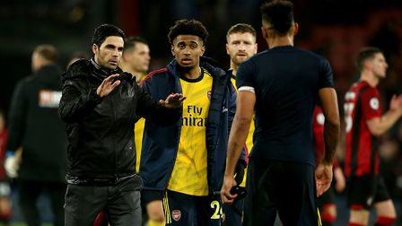 Arsenal's manager Mikel Arteta with Reiss Nelson after their match at Bournemouth