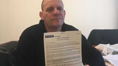 Andrew William Coleman with the Threat to Life notice given to him by police. Picture: Nathalie Raff