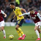 Arsenal's Pierre-Emerick Aubameyang (left) and Burnley's Matthew Lowton battle for the ball during t
