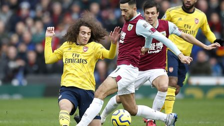 Arsenal's Matteo GuendouziÊ(left) and Burnley's Dwight McNeil battle for the ball during the Premier